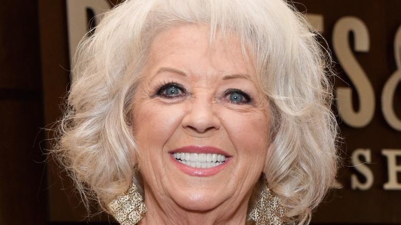 Paula Deen wearing large earrings