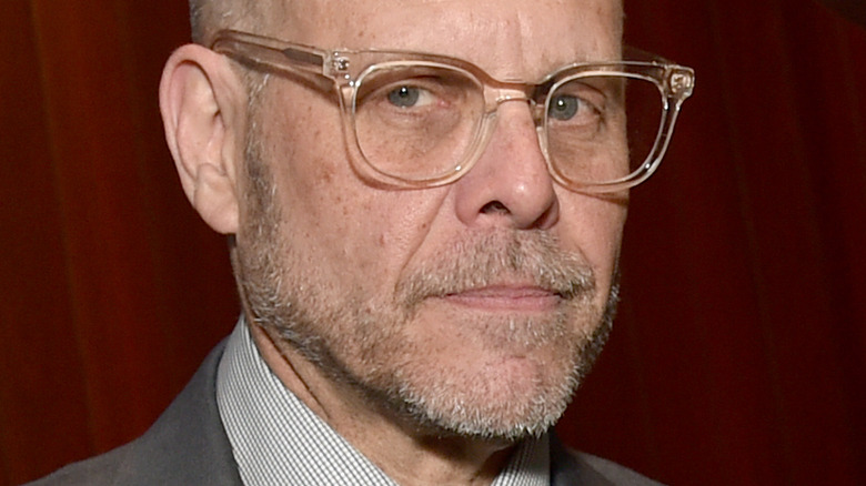 Alton Brown with clear glasses and serious expression