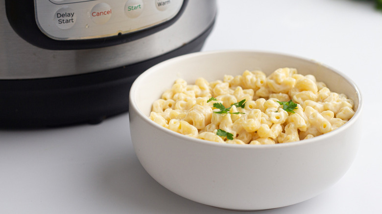 macaroni and cheese next to Instant Pot