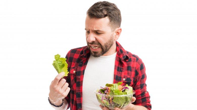 man horrified by lettuce