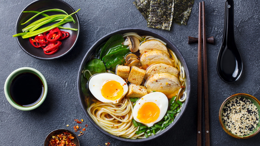 A bowl of ramen with sides