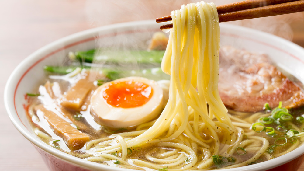 Ramen noodles wrapped around chopsticks