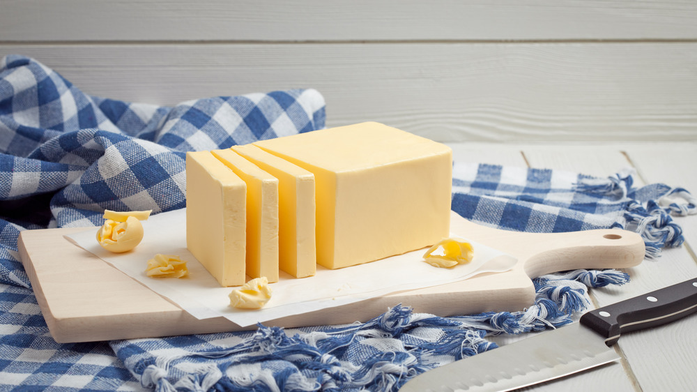 Stick of butter on cutting board