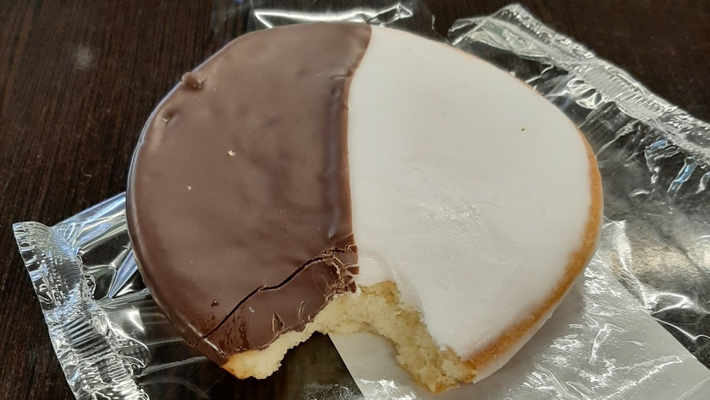 Black and white cookie with a bite