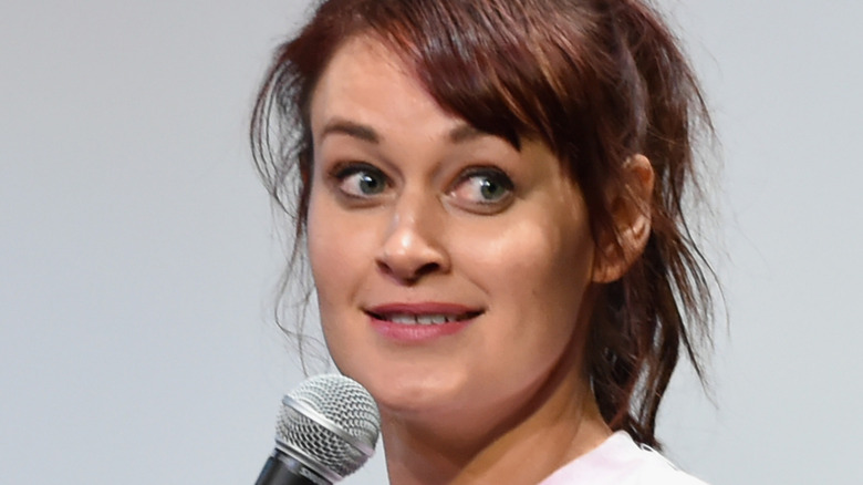 Mamrie Hart smiling over microphone