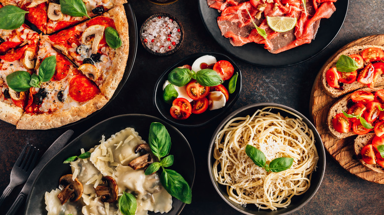 Pasta, pizza and Italian dishes on table