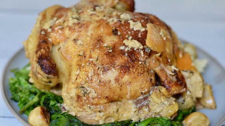 whole roasted chicken on bed of spinach