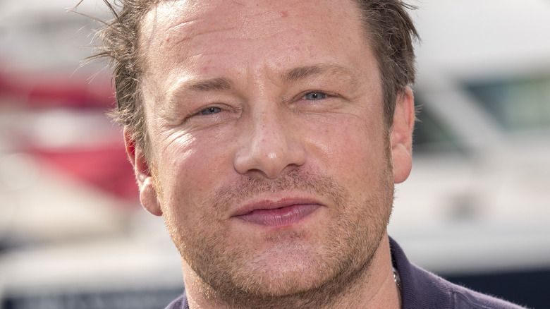 Jamie Oliver outside and smirking