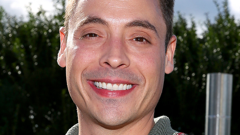 Jeff Mauro smiling at an event