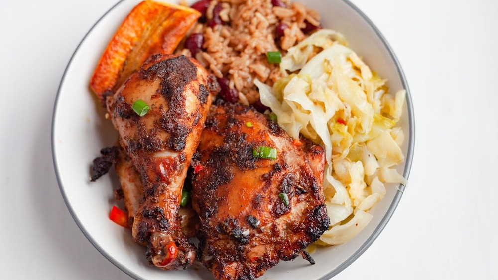 Jerk chicken on a plate with sides