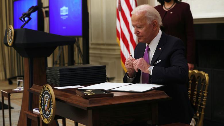 Joe Biden signing papers