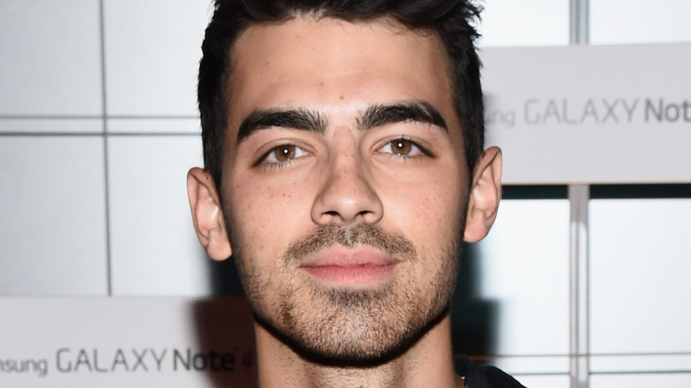 Joe Jonas smiling at event