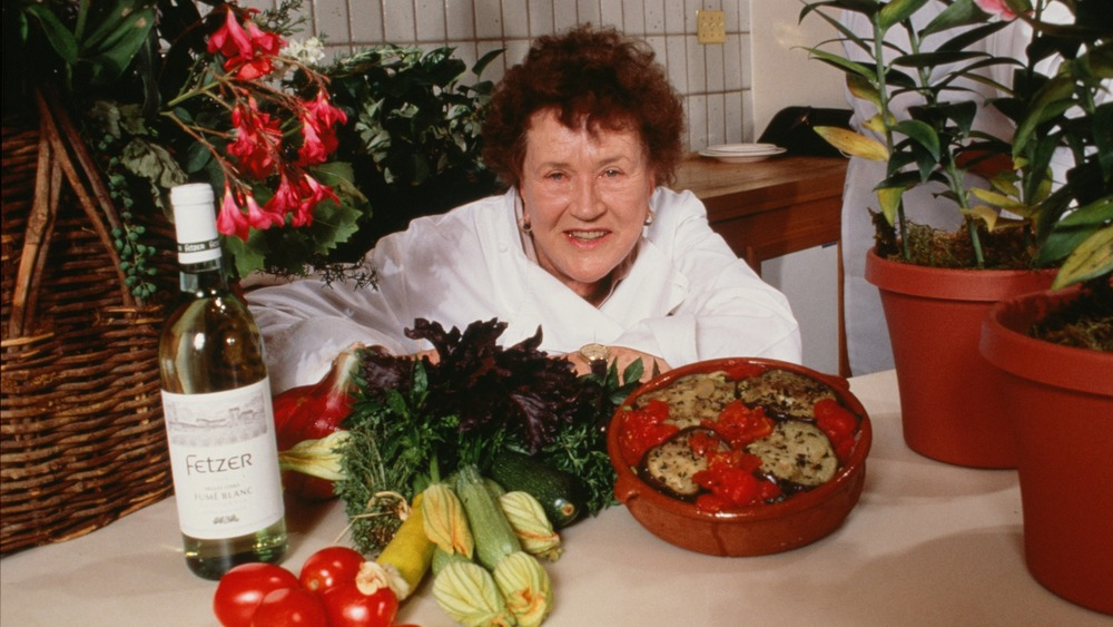 Julia Child decked with all kinds of food. No mayonnaise sadly, though that would probably mixed oddly with the dish she prepared.