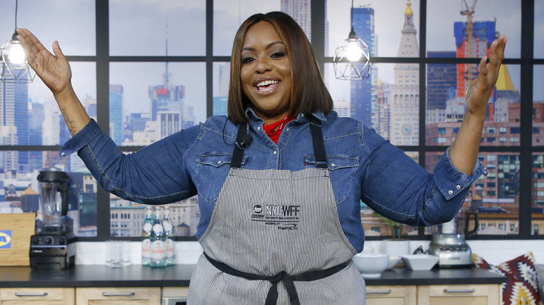 Kardea Brown smiling at culinary demonstration