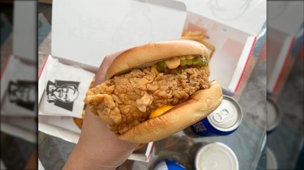 Hand holding new KFC chicken sandwich