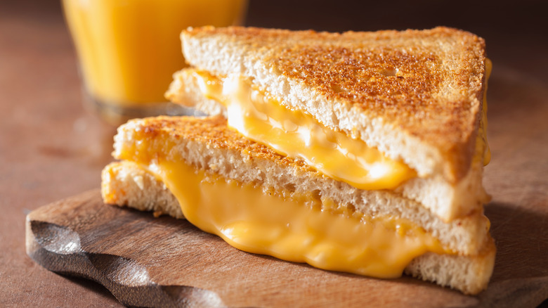 grilled cheese with cheese oozing out