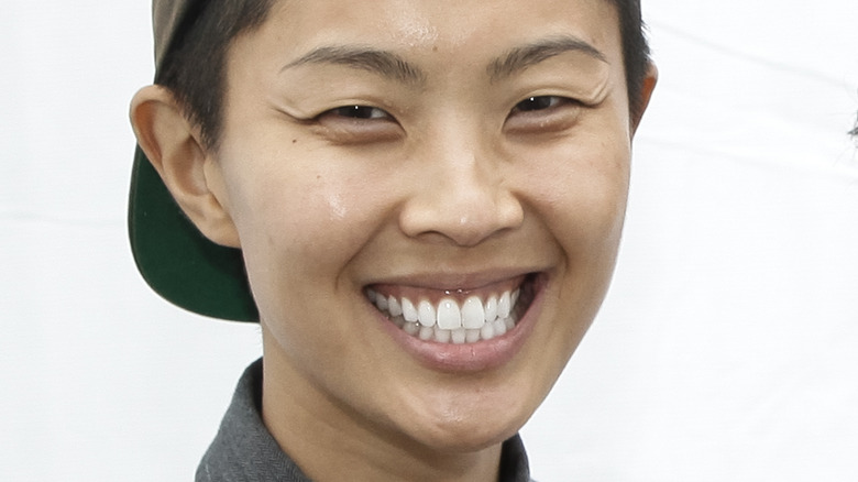 Kristen Kish smiling in cap