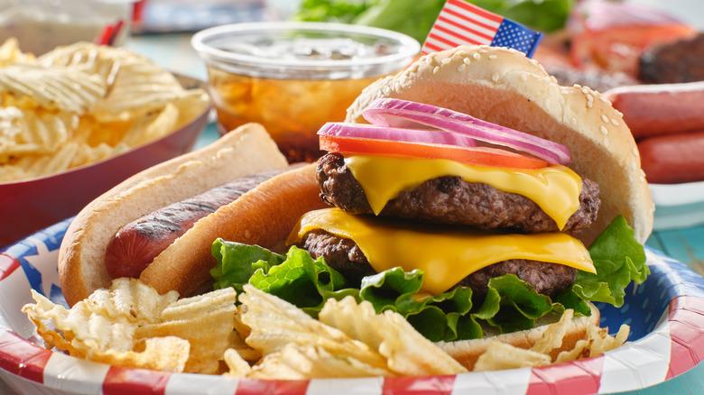 Hamburger and hot dog on plate