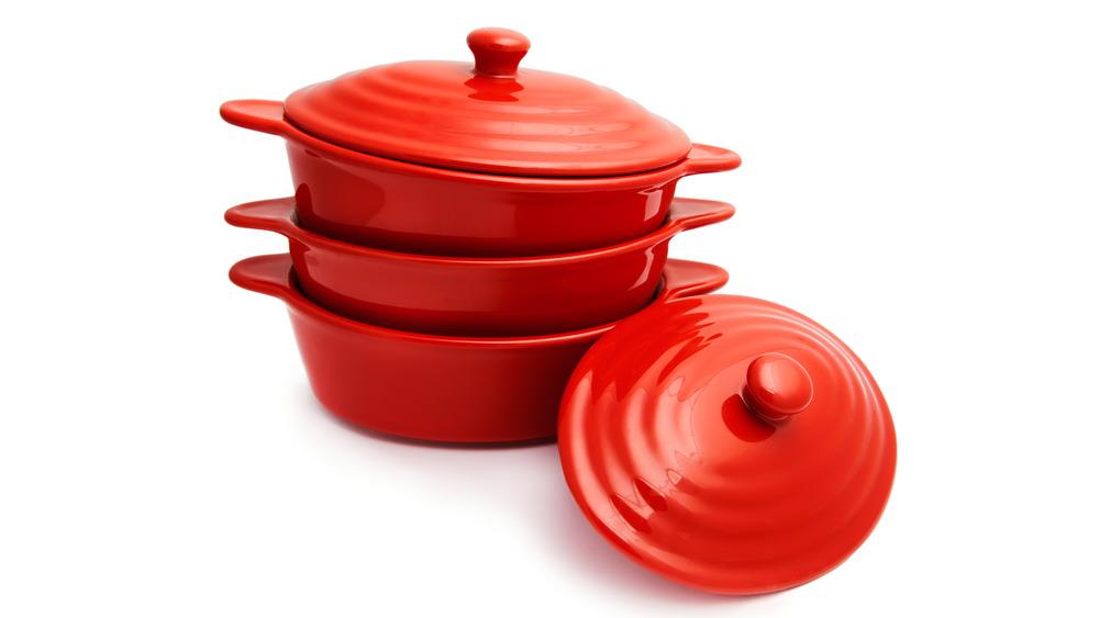 Three Le Creuset red pots