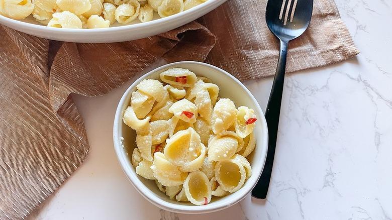 pasta shells in white ramekin
