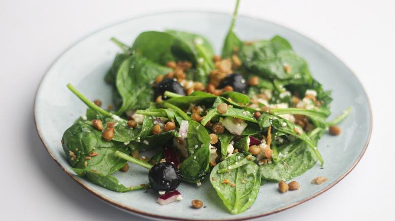Lentil spinach salad on plate