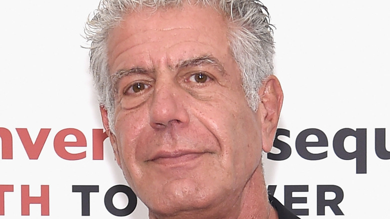 Anthony Bourdain smiling at event