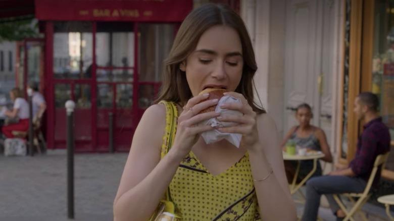 Emily in Paris eating pain au chocolat