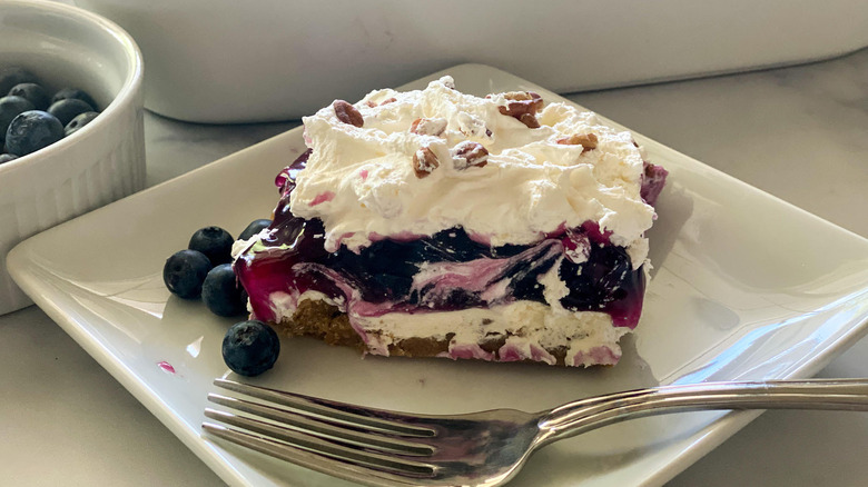Luscious Layered Blueberry Delight served on a plate