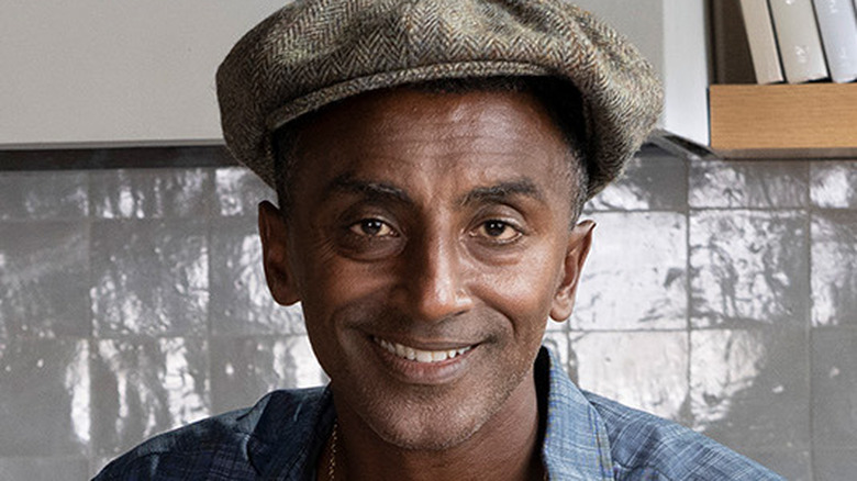 Chef Marcus Samuelsson in a hat smiling