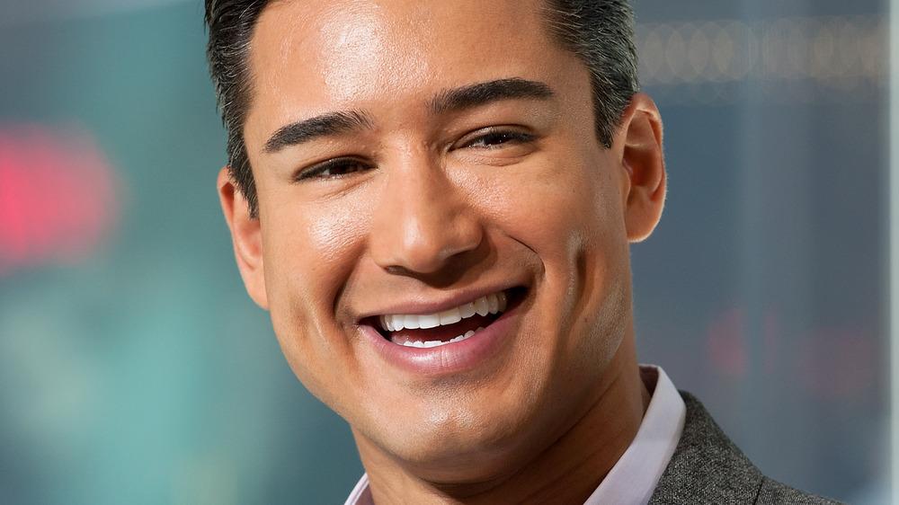 Mario Lopez smiling in suit