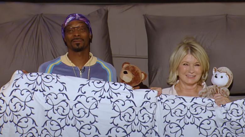 Martha and Snoop in a bed