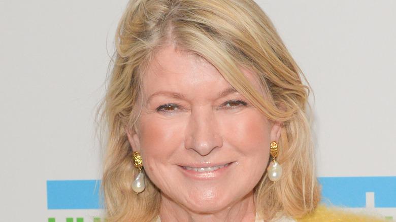 Martha Stewart in golden pearl earrings
