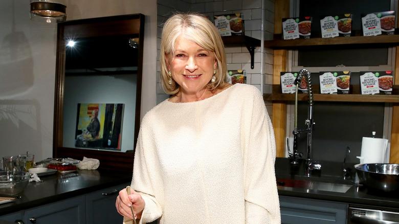 Martha Stewart posing in a kitchen