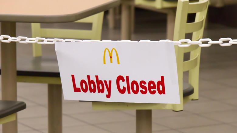 """A """"lobby closed"""" sign in a McDonald's"""