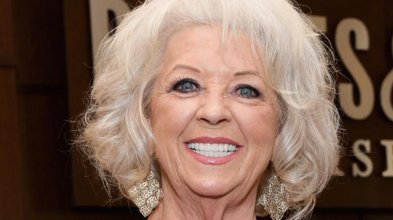 Paula Deen smiling wearing earrings