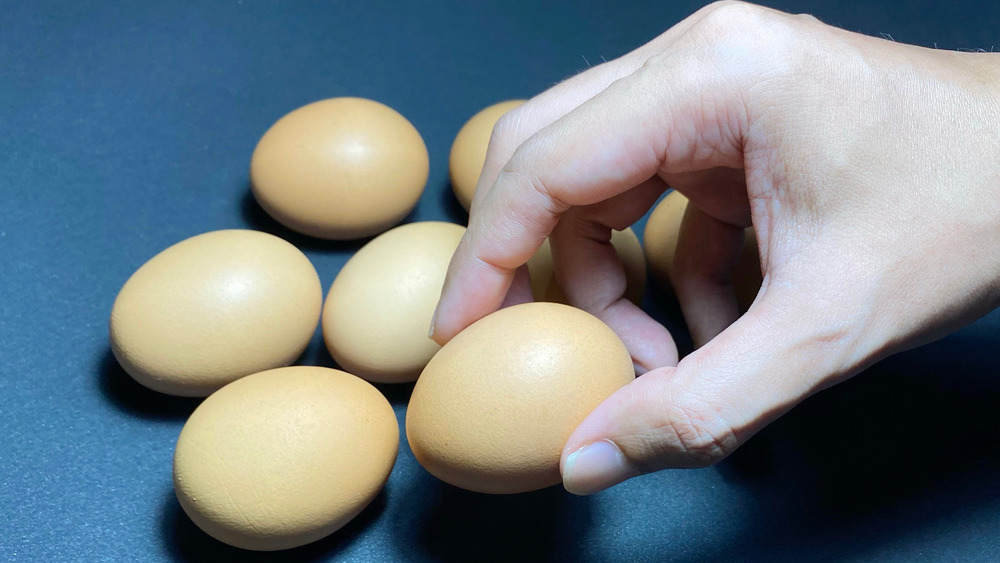 picking out a brown egg