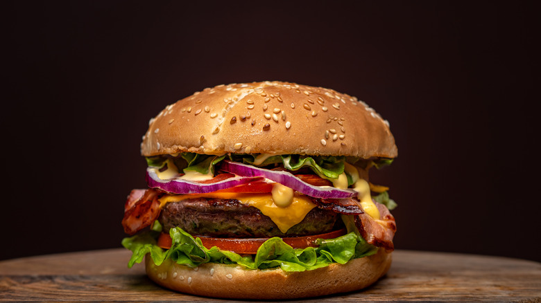 burger with bacon and cheese and veggies
