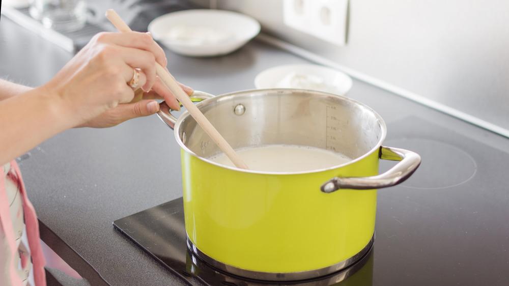 making bechamel sauce in a lemon colored pot