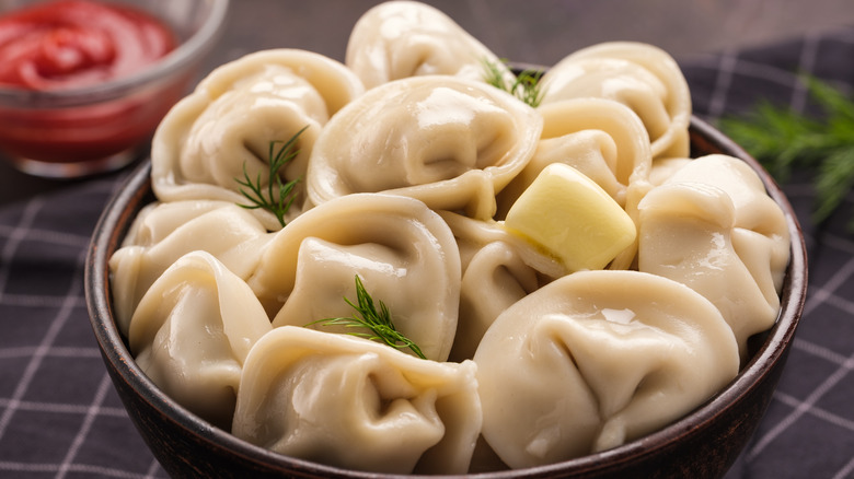 dumplings in a bowl topped with butter