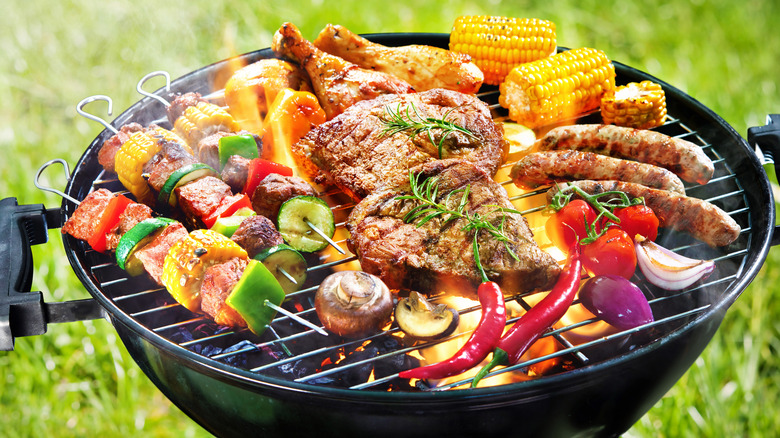 meat and veggies on grill