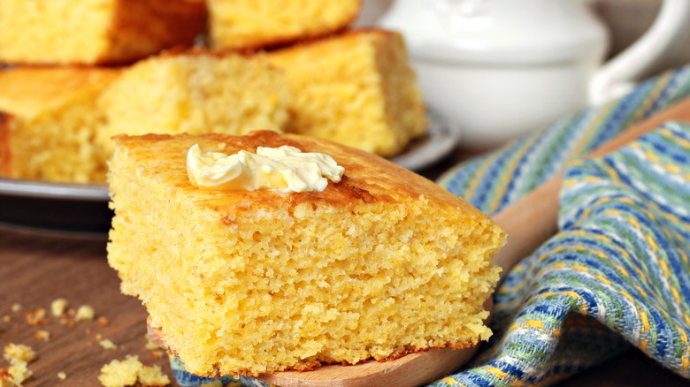 Cornbread cut up in squares on plate