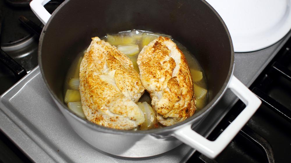 Chicken braising in a pot