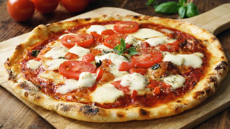 Homemade margherita pizza on board