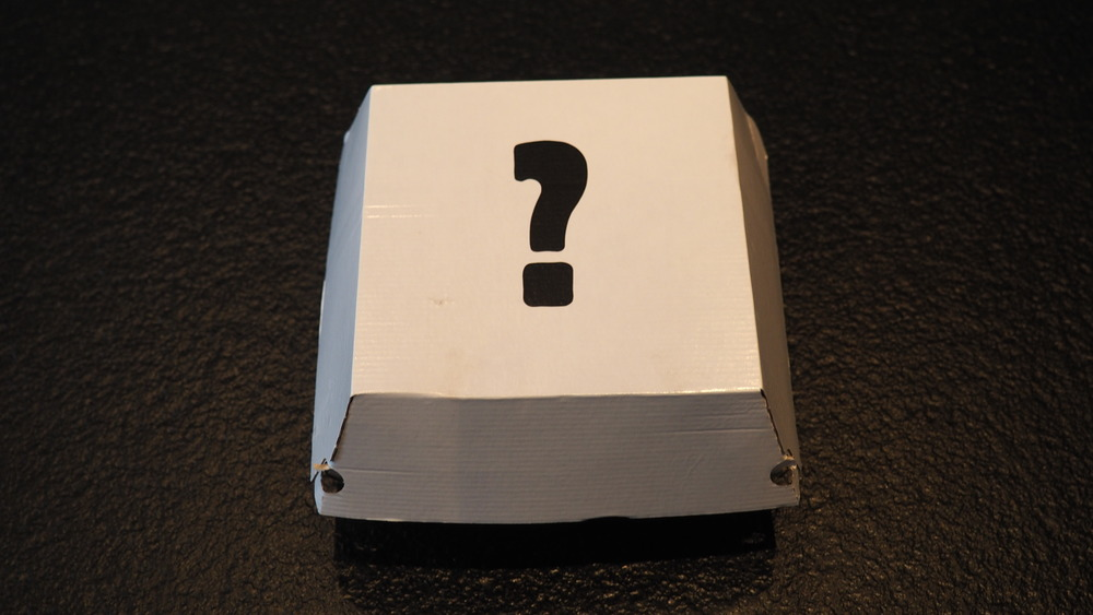 A burger box adorned with a question mark