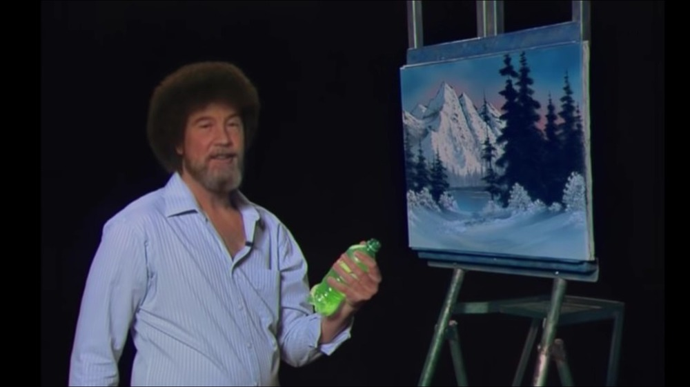Bob Ross with painting and Mountain Dew bottle