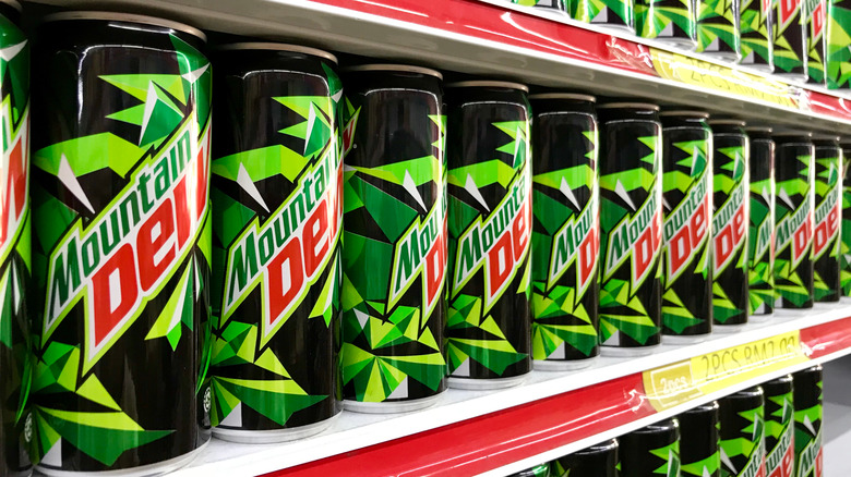 Mountain Dew cans on a shelf