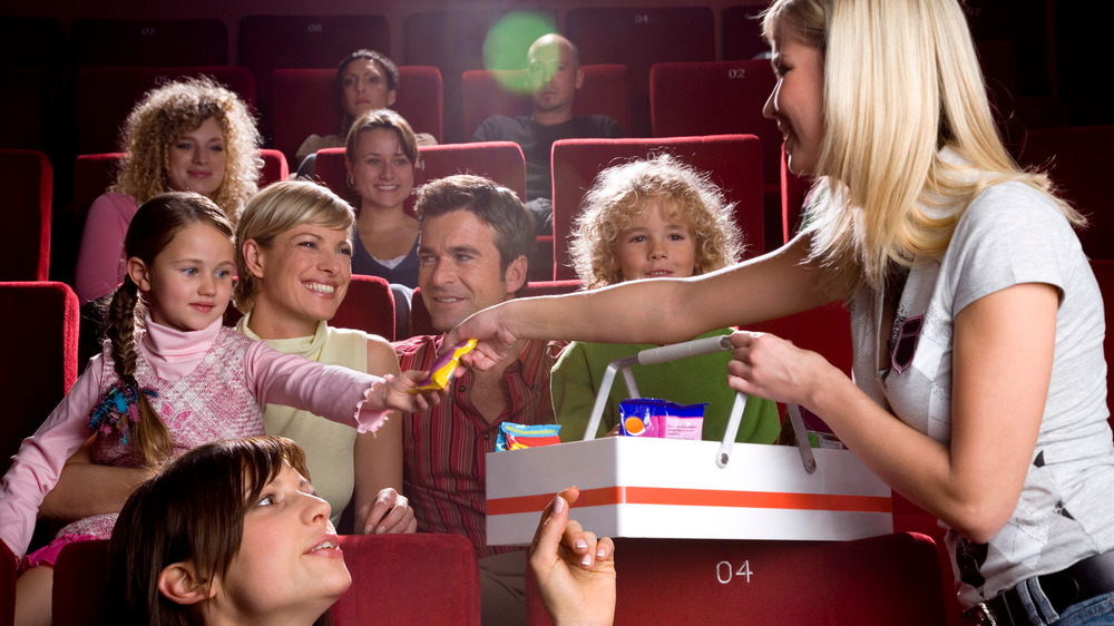 Family buying candy and popcorn at the movie theater