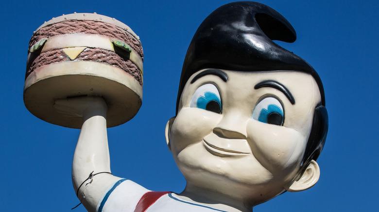 Big Boy cartoon sculpture holding a hamburger
