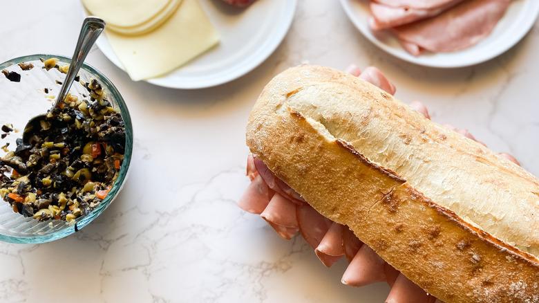 A Muffaletta sandwich served on a plate
