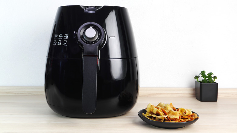 air fryer and vegetable chips on a plate